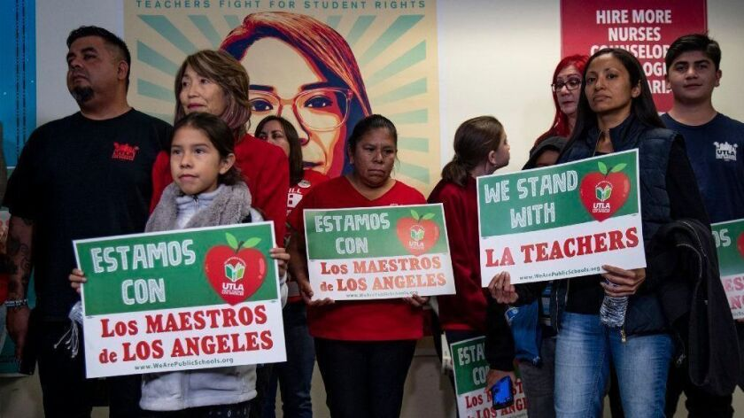 Parents, students and educators attend a Dec. 21 UTLA news conference calling for a cap on LAUSD charter schools.