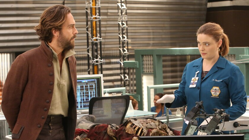 "Ichabod Crane (Tom Mison) in crossover episodes of ""Bones"" and ""Sleepy Hollow."" With Emily Deschanel."