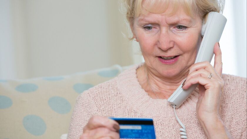 Senior Woman Giving Credit Card Details On The Phone ** OUTS - ELSENT and FPG - OUTS * NM, PH, VA if