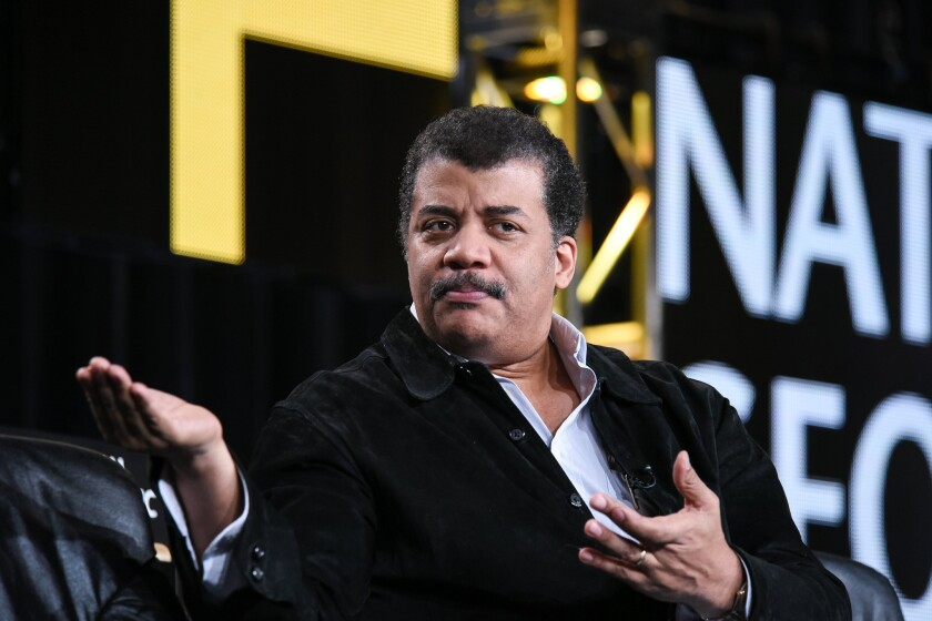 Astrophysicist Neil deGrasse Tyson discusses his upcoming National Geographic Channel show at the Television Critics Assn. press tour in Pasadena on Jan. 7.