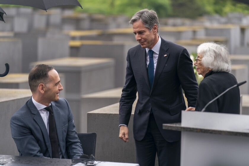 Holocaust Survivor Margot Friedlander, right, is greeted by U.S. Secretary of State Antony Blinken, center, and German Minister of Foreign Affairs Heiko Maas, left, after speaking at a ceremony for the launch of a U.S.-Germany Dialogue on Holocaust Issues at the Memorial to the Murdered Jews of Europe in Berlin, Thursday, June 24, 2021. Blinken is on a week long trip in Europe traveling to Germany, France and Italy. (AP Photo/Andrew Harnik, Pool)