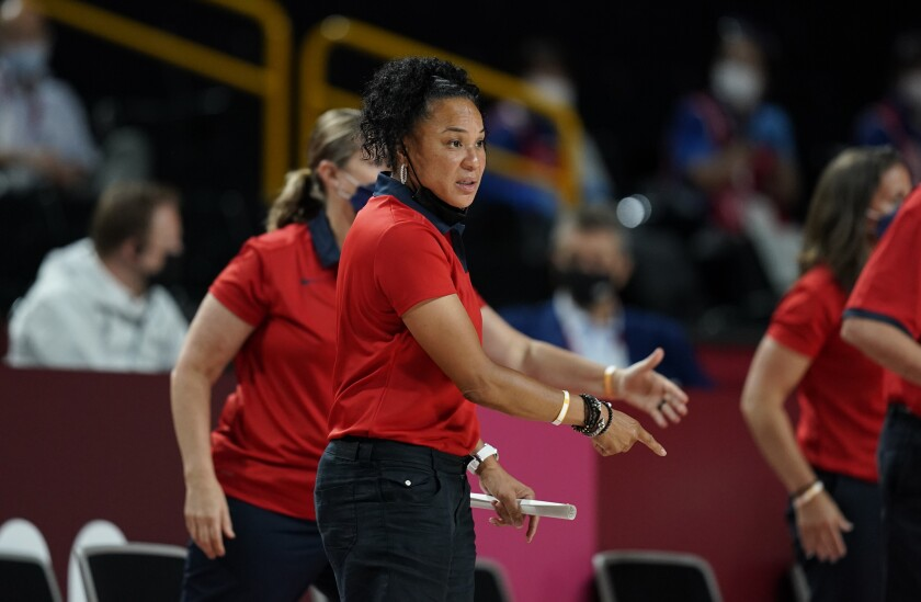 United States' head coach Dawn Staley gestures to the players during women's basketball gold medal game against Japan at the 2020 Summer Olympics, Sunday, Aug. 8, 2021, in Saitama, Japan. (AP Photo/Charlie Neibergall)