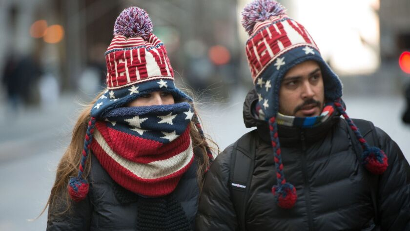 People are bundled up against the cold on January 2, 2018 in New York.