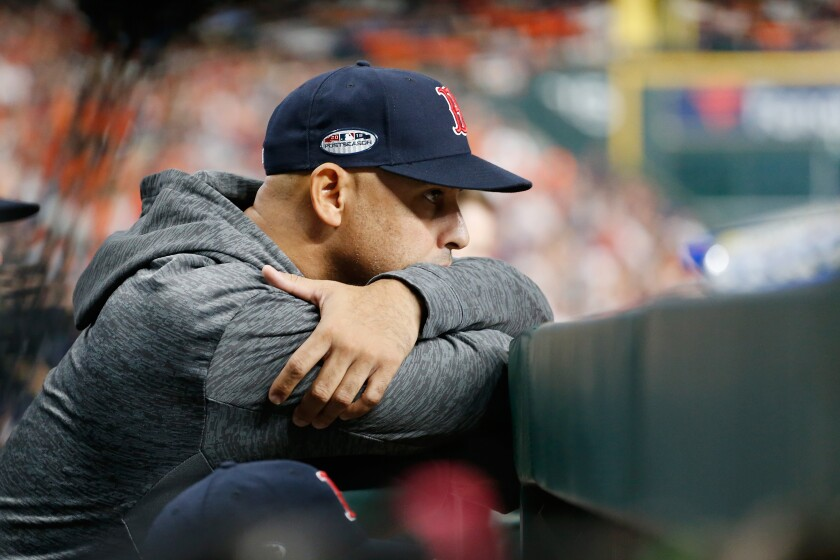 Then-Red Sox manager Alex Cora looks on during Game 5 of the 2018 ALCS against the Astros in in Houston.