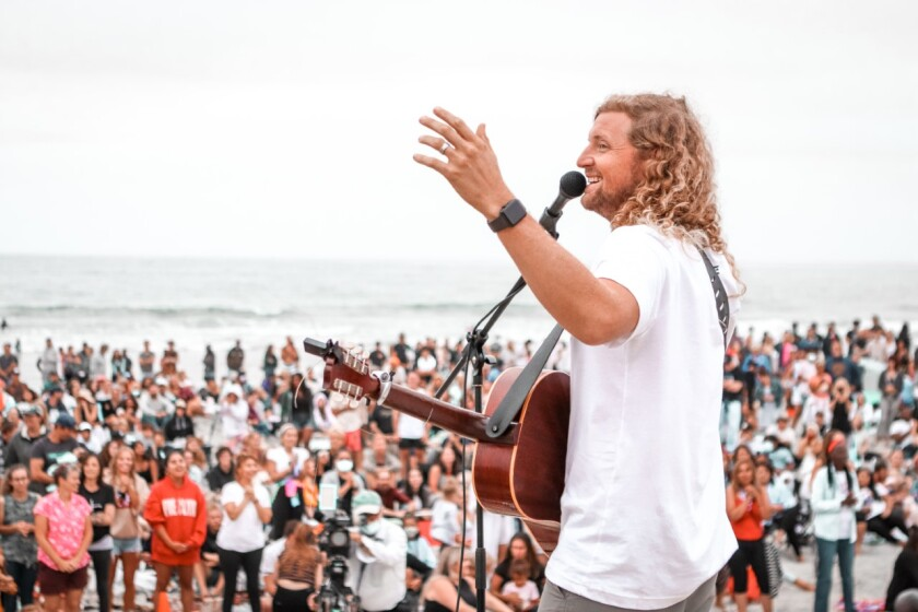 Sean Feucht holds a worship service on Cardiff State Beach on July 26.