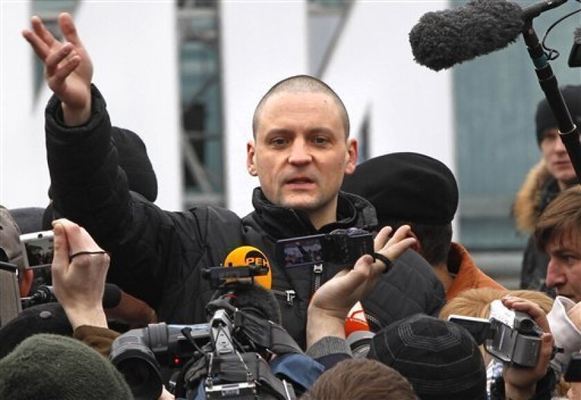 Opposition leader Sergei Udaltsov, center, speaks at an unsanctioned rally at Pushkin Square in Moscow, Russia, Saturday, March 31, 2012. Sergei Udaltsov, an opposition leader who had already been detained twice this month at protests following Putin's victory in a March 4 presidential election, wa