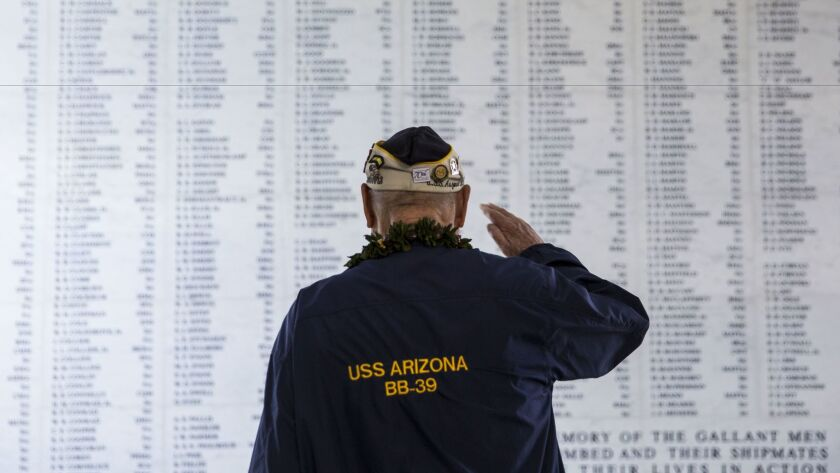 U.S.S. Arizona survivor Louis Conter salutes the remembrance wall of the U.S.S. Arizona during the 73rd anniversary of the attack on the U.S. naval base at Pearl harbor on Dec. 07, 2014.