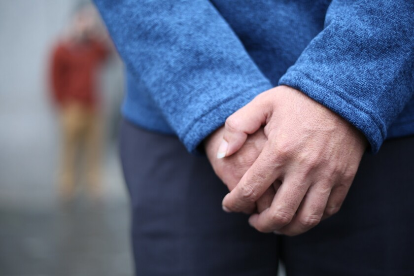 The hands of a Honduran father separated from his son at the Mexican border are pictured in front of the Daniel Patrick Moynihan Federal Courthouse on Monday in New York. Attorneys for the man insisted that only their client's hands be photographed for his protection.