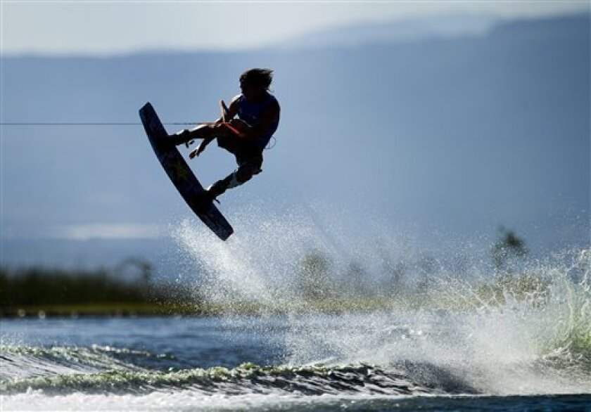Canada's Aaron Christopher Rathy competes in the men's wakeboarding final during the 2011 Pan American Games in Guadalajara, Mexico on Saturday, Oct. 22, 2011. Rathy won silver. (AP Photo/The Canadian Press, Nathan Denette)