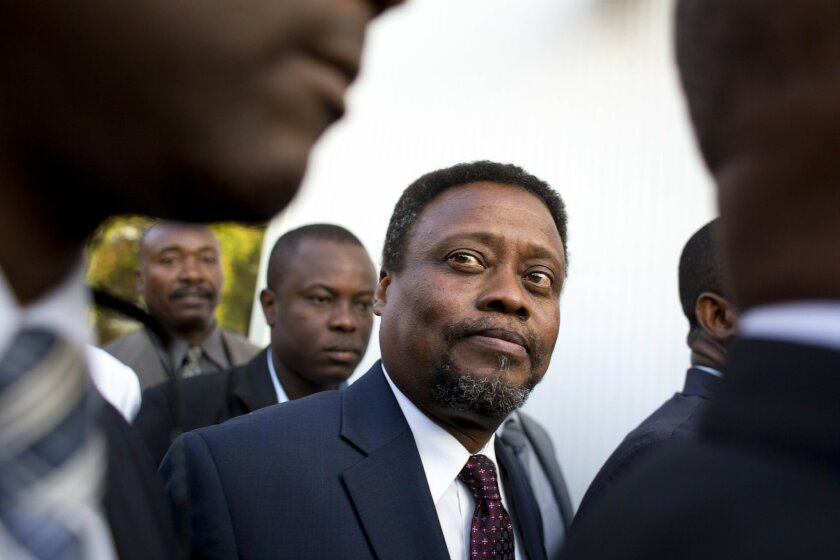 FILE - In this Feb. 26, 2016 file photo, Haiti's new interim Prime Minister Fritz Jean arrives for his induction ceremony at the National Palace in Port-au-Prince, Haiti. A majority of lower house lawmakers rejected Jean for prime minister on Sunday, March 20, 2016, leaving the interim government in limbo. Jean is an economist and former governor of Haiti's central bank. (AP Photo/Dieu Nalio Chery, File)