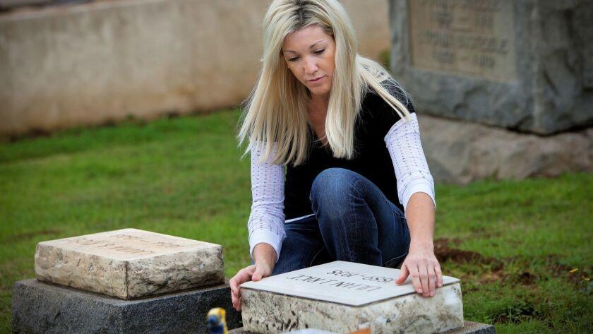 Tara Tarrant installs a new head stone marker on the grave site of famed California architect Lillian Rice. The new marker has Rice's correct birth date.
