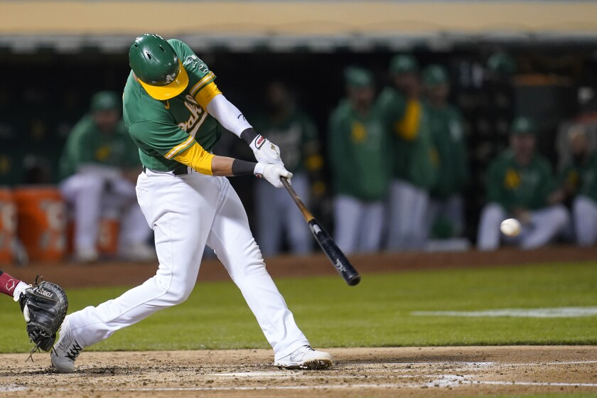 Oakland Athletics' Yan Gomes hits an RBI single against the Chicago White Sox during the fourth inning of a baseball game in Oakland, Calif., Wednesday, Sept. 8, 2021. (AP Photo/Jeff Chiu)