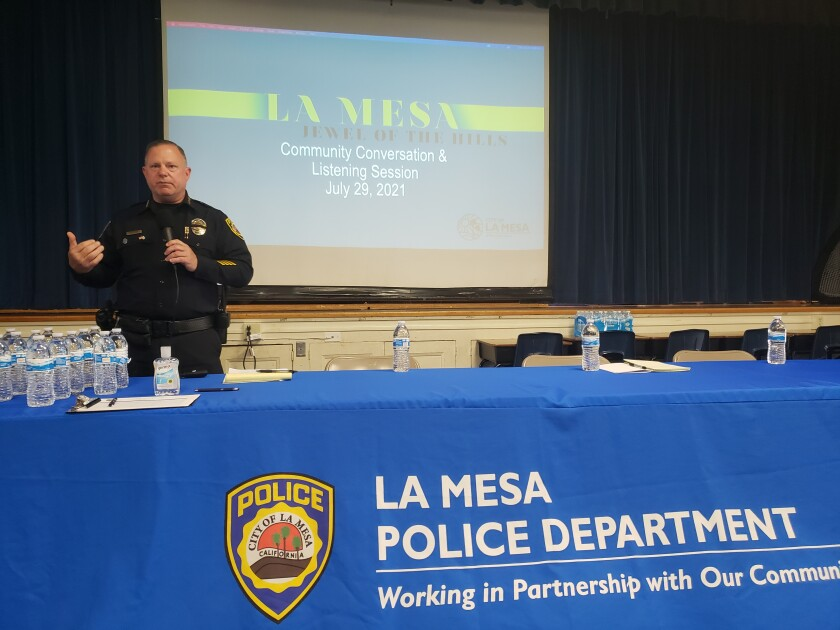 La Mesa Police Chief Ray Sweeney greets community members at listening session Thursday at Rolando Elementary School.