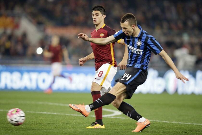 Inter Milan's Ivan Perisic, right, follows the ball to during a Serie A soccer match between Roma and Inter Milan, at Rome's Olympic Stadium, Saturday, March 19, 2016. (AP Photo/Andrew Medichini)