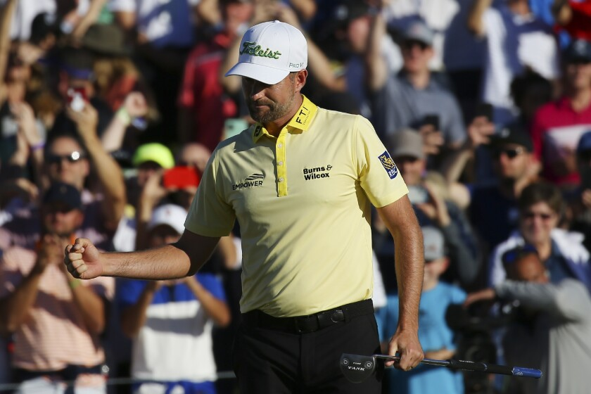 Webb Simpson pumps his fist after sinking the winning putt on the first playoff hole during the final round of the Waste Management Phoenix Open PGA Tour golf event Sunday, Feb. 2, 2020, in Scottsdale, Ariz. (AP Photo/Ross D. Franklin)