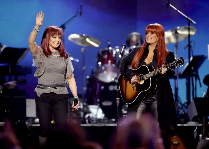FILE - In this April 4, 2011 file photo, The Judds, Naomi Judd, left, and Wynonna Judd perform at the Girls' Night Out: Superstar Women of Country in Las Vegas. The Judds are reuniting after nearly five years to perform a series of shows in Las Vegas. AEG Live and The Venetian casino announced on Monday, Aug. 24, 2015, that the duo will perform nine shows Oct. 7 through Oct. 24 at The Venetian Theatre. (AP Photo/Julie Jacobson, File)