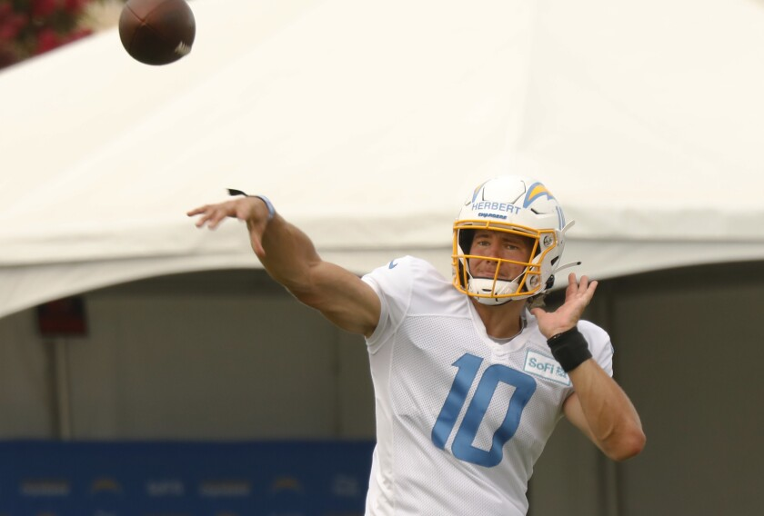 Chargers rookie quarterback Justin Herbert throws a during training camp practice.
