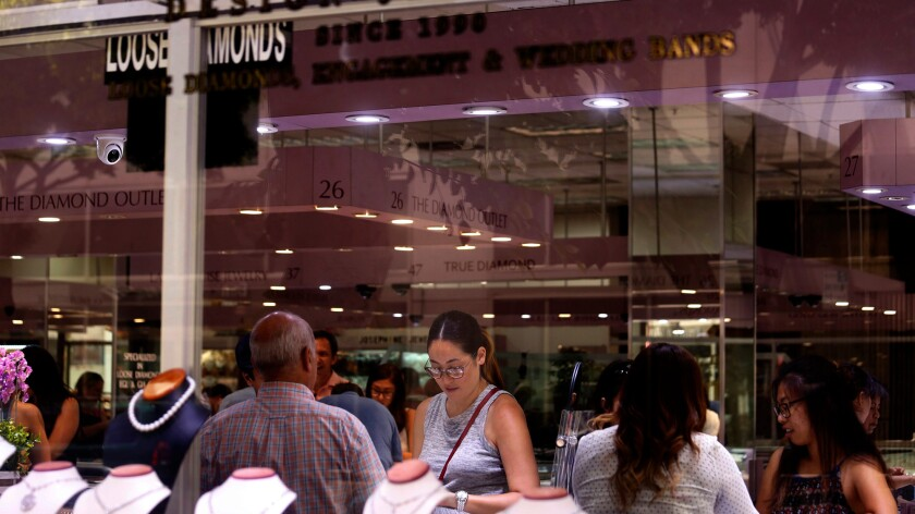 Shoppers look over jewelry inside the Western Jewelry Mart on 6th Street in downtown Los Angeles.