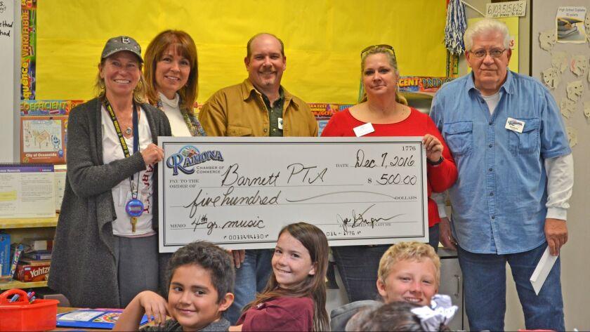 Barnett Elementary fourth-grade teacher Victoria Barlow, left, receives a $500 educational grant for fourth-grade music from Ramona Chamber, represented by Karen Domnitz, Joe Stupar, Amber Ramirez and Bob Murray.