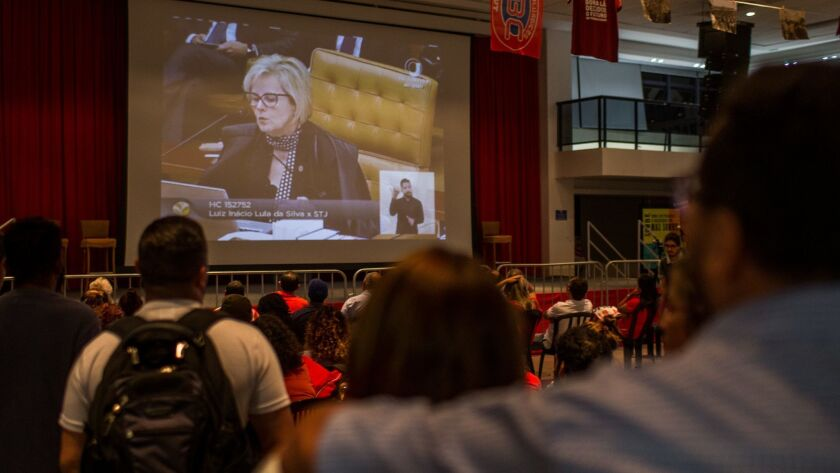 Supporters of former president Luiz Inacio Lula da Silva watch Justice Rosa Weber at a session of the Federal Supreme Court on a large screen television at the headquarters of the Metalworkers' Union on April 4, 2018 in Sao Paulo, Brazil.