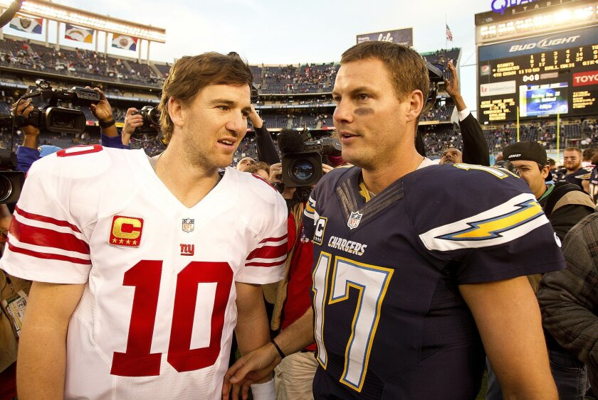 . The San Diego Chargers vs. The New York Giants at Qualcomm Stadium. Eli Manning and Philip Rivers after the Chargers 37-14 win over the Giants.