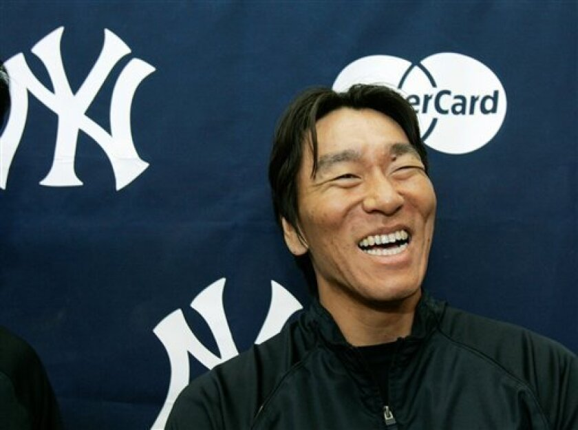 New York Yankees outfielder Hideki Matsui laughs as he discusses his marriage during a news conference at Legends Field in Tampa, Fla., Thursday, March 27, 2008. Matsui was married Wednesday in New York. (AP Photo/Kathy Willens)