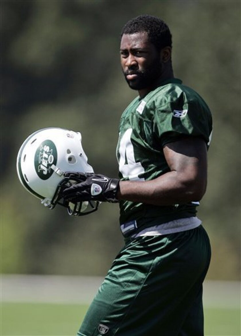 New York Jets cornerback Darrelle Revis walks onto the field for football practice at the team's training facility in Florham Park, N.J., on Tuesday, Sept. 7, 2010. Revis, who had been holding out since Aug. 1, signed a new contract on Monday. (AP Photo/Rich Schultz)