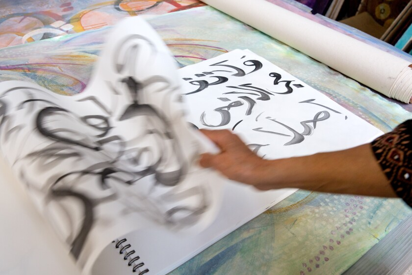 Artist Salma Arastu flips through some of her work. Some art incorporating Islamic calligraphy centers on the meaning of the passage; others treat letters more like graphic objects.