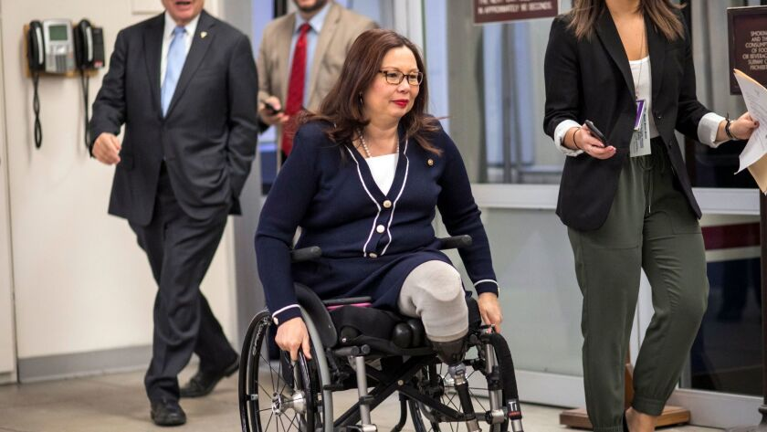 Sen. Tammy Duckworth (D-Ill.) arrives for a vote at the Capitol last month.