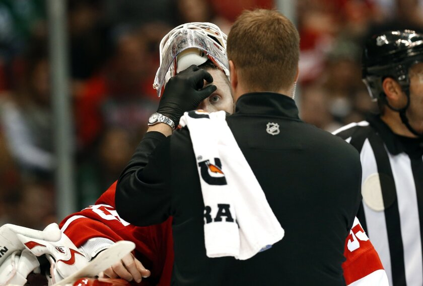 Detroit Red Wings goalie Jimmy Howard (35) has his eye checked against the Dallas Stars in the third period of an NHL hockey game, Sunday, Nov. 8, 2015 in Detroit. Howard left the game. (AP Photo/Paul Sancya)
