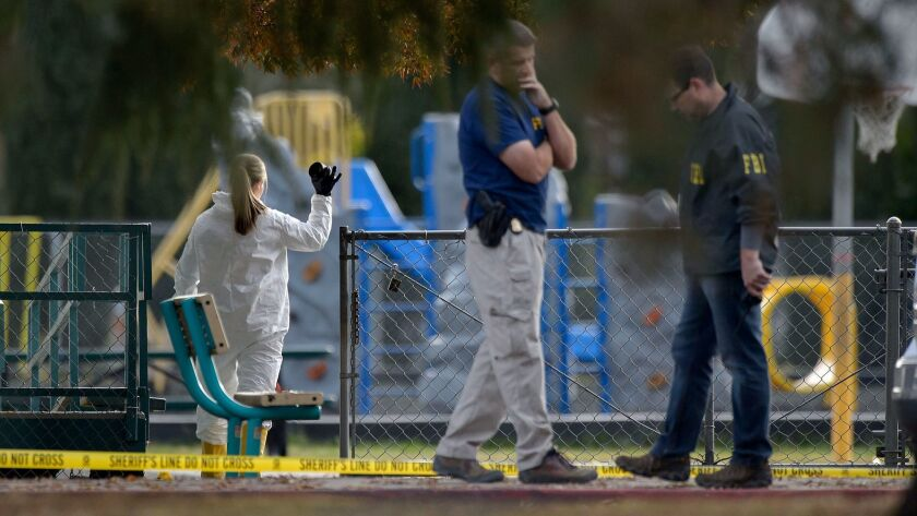 FBI investigators process evidence at the Rancho Tehama Elementary School on Tuesday.