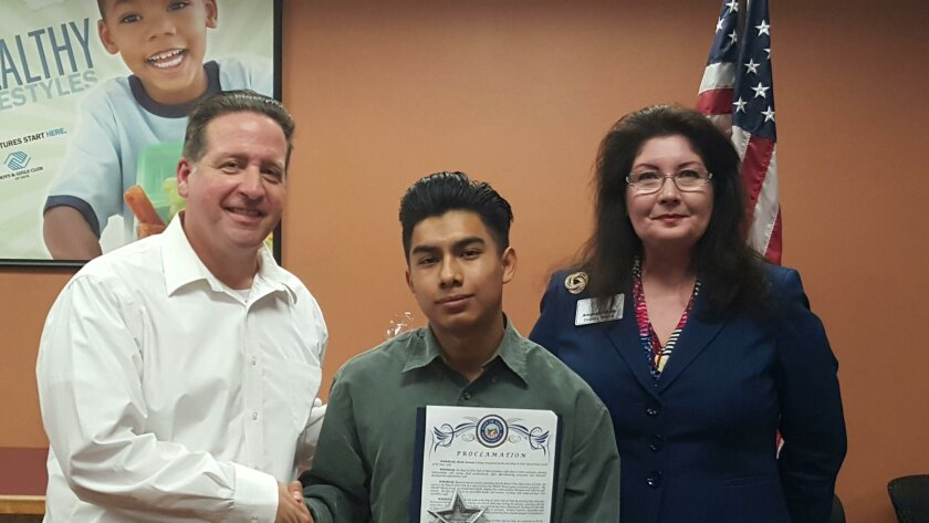 Mark Arenas, a Rancho Buena Vista High student, was named 2015 Youth of the Year for the Boys & Girls Club of Vista and was chosen from 1,300 members. Vista Deputy Mayor Amanda Rigby (right) presented Arenas (center) with a certificate naming Jan. 29 Mark Arenas Day in Vista. At left is Matt Koumar