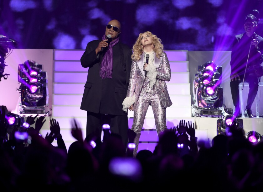 Stevie Wonder and Madonna perform a tribute to Prince.