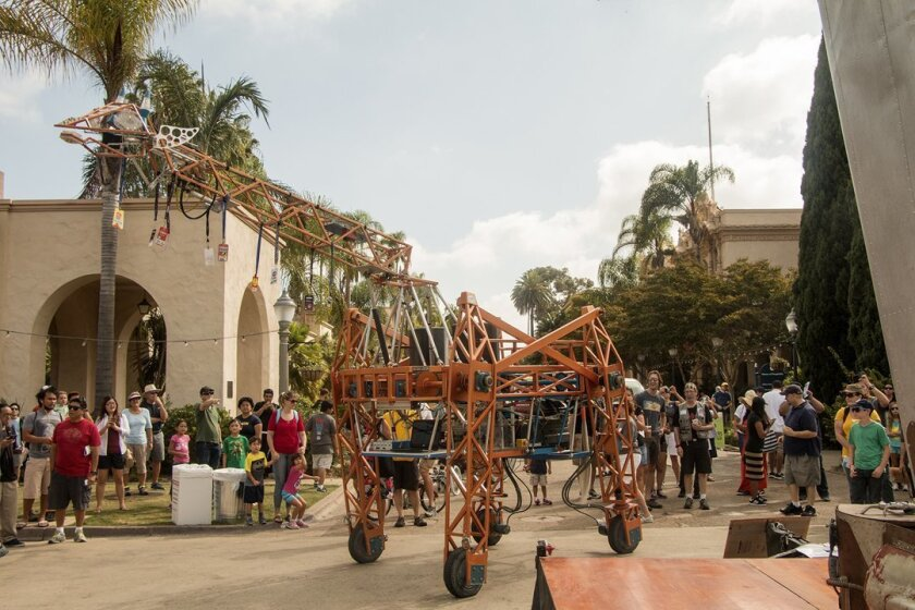 A life-size robotic giraffe is one of the crowd-pleasers during Maker Faire San Diego, held Oct. 3-4, 2015 in Balboa Park.