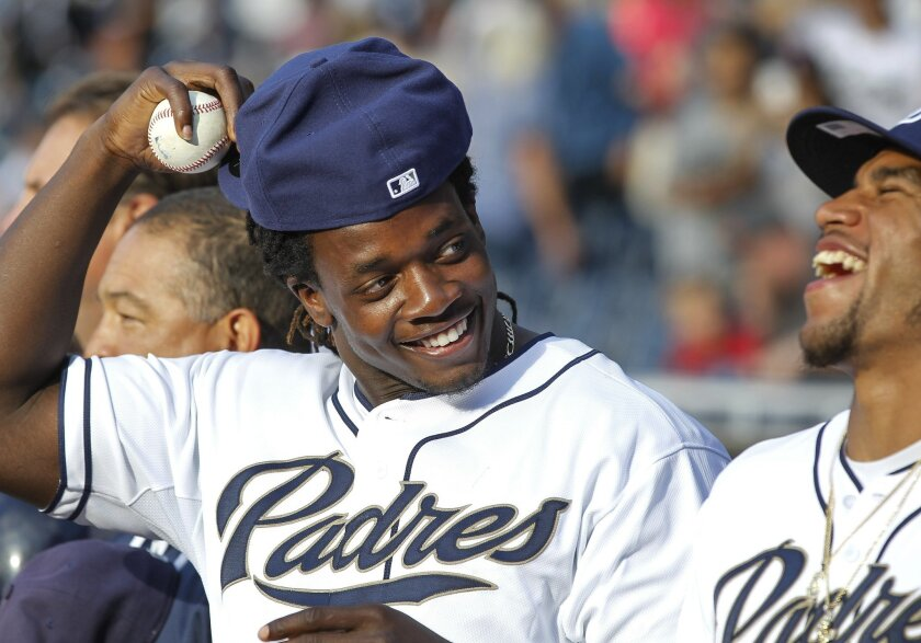 Chargers draft picks Melvin Gordon, left, and Craig Mager share a laugh before the Padres game against the Mets.