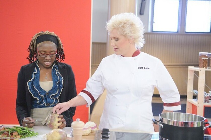 """Chef Anne with contestant Wilhelmena on the set of """"Worst Cooks in America."""""""