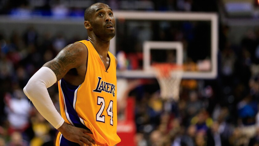 Lakers star Kobe Bryant looks on during the closing moments of a 111-95 loss to the Washington Wizards on Dec. 3, 2014.
