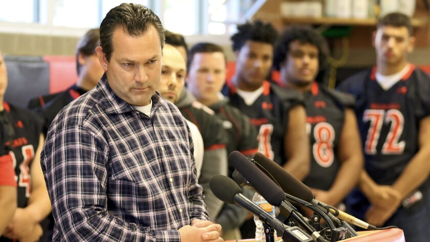 Jerry Jensen, Archbishop Murphy's head coach and athletic director, fields questions during a news conference with his players. Several schools have forfeited games against the Wildcats after they won their first three games by a combined score of 170-0.