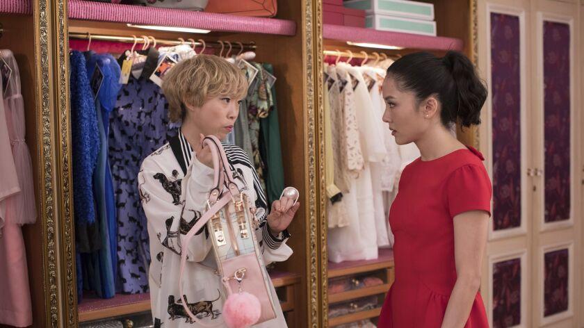This image released by Warner Bros. Entertainment shows Awkwafina, left, and Constance Wu in a scene