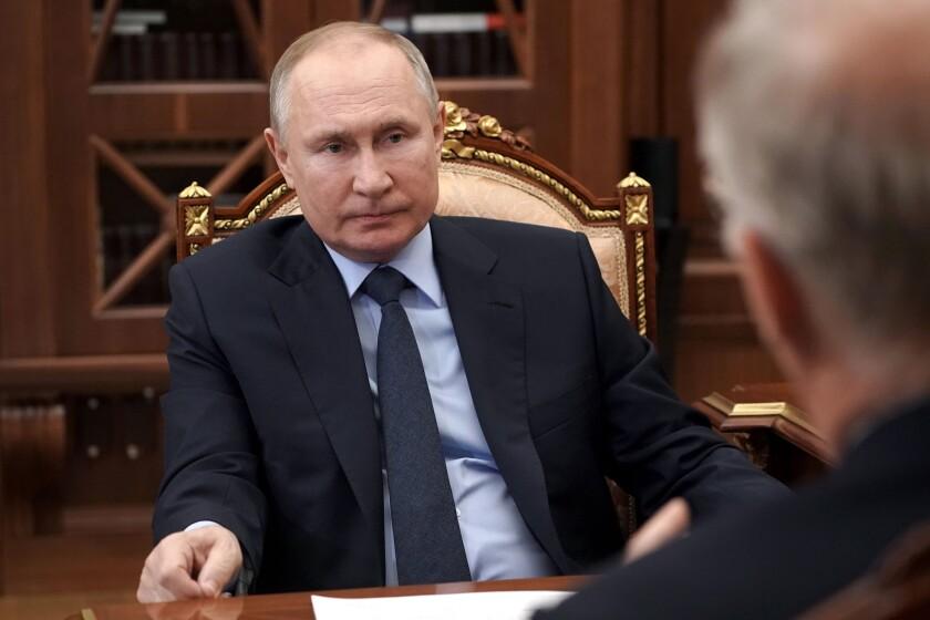 Russian President Vladimir Putin listens to General Director of the Russian Direct Investment Fund Krill Dmitriev at the Kremlin in Moscow, Russia, Friday, April 2, 2021. (Alexei Druzhinin, Sputnik, Kremlin Pool Photo via AP)