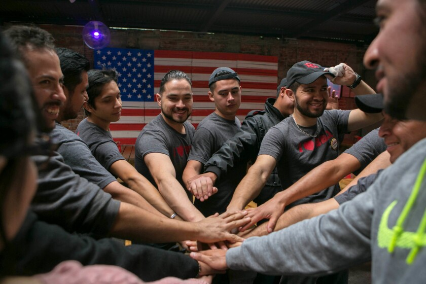 May 8, 2018 - The staff at Pinche Gringo cheers before opening for the day. Pinche Gringo is a popu