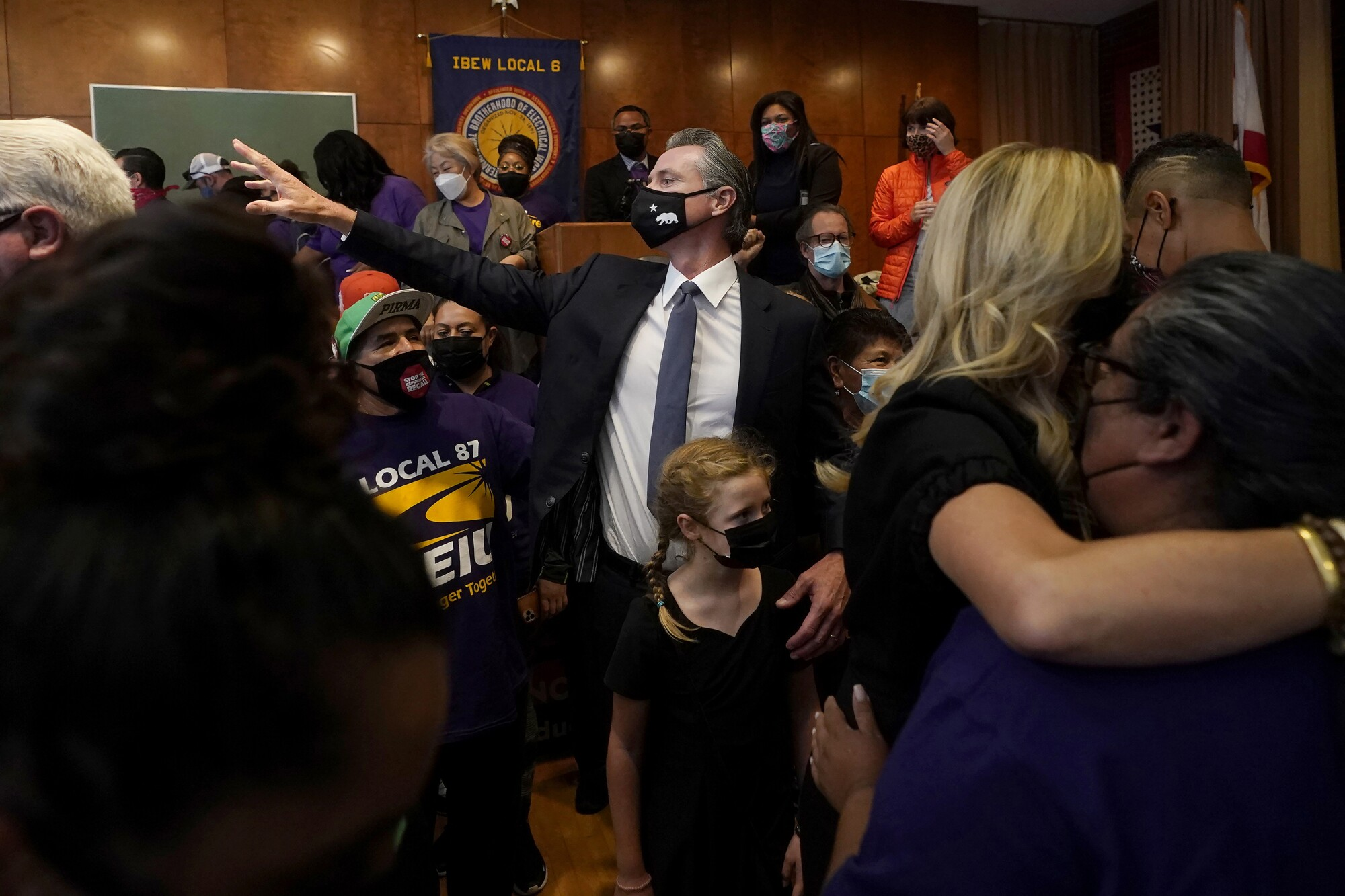 Gov. Gavin Newsom with his daughter in a crowded room