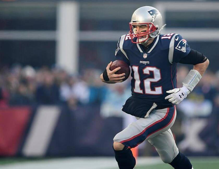New England Patriots quarterback Tom Brady scrambles against the Jacksonville Jaguars in the first quarter of the AFC Championship game at Gillette Stadium in Foxborough, Massachusetts, USA, 21 January 2018. EFE