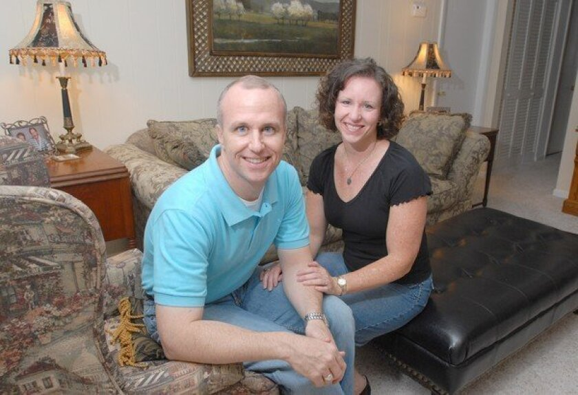 Alan Chambers, left, president of Exodus International, with his wife, Leslie, in their home in Florida in 2006.