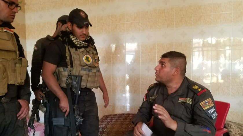 Lt. Col. Ali Hussein Fadil, right, directs some of the 166 Najaf-based special forces soldiers under his command, including Saud Messoud Jamal, 31, left, whose Mosul-area village the offensive has freed from Islamic State.