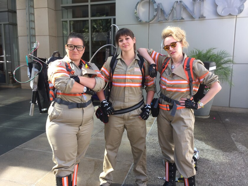 """Three fans of the new """"Ghostbusters"""" movie, captured Friday at Comic-Con in San Diego."""