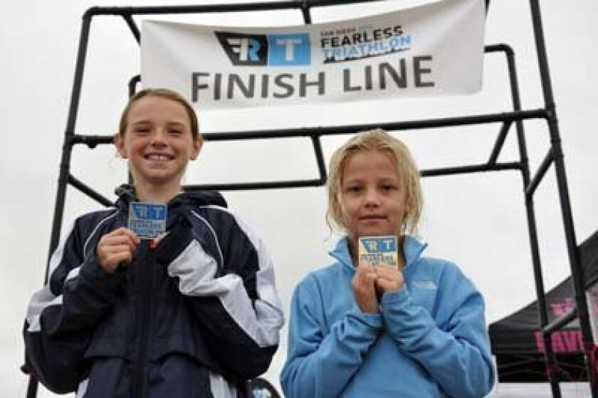 Maya Pratt Freedman, 10, and Bella Otterson, 9, competed in the Fearless Triathlon. Photo: John Otterson