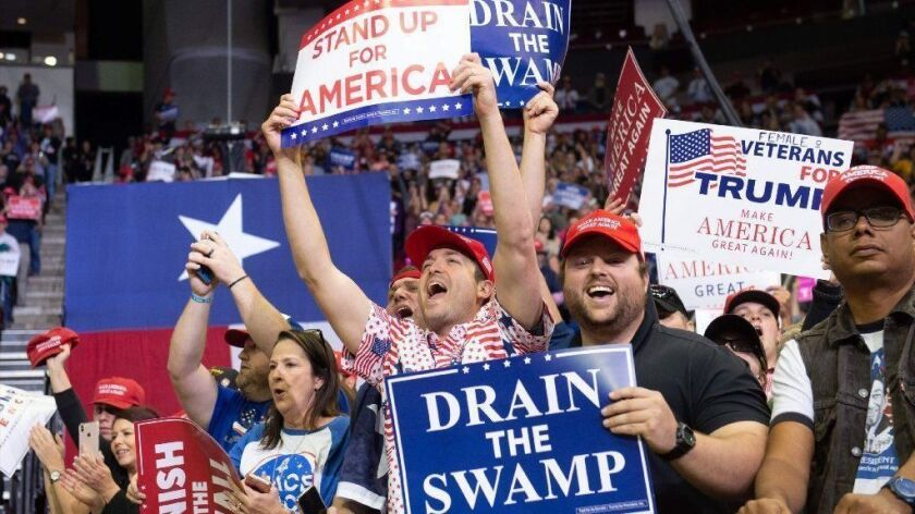 Supporters cheer for President Trump during a campaign rally in Houston on Oct. 22, 2018.