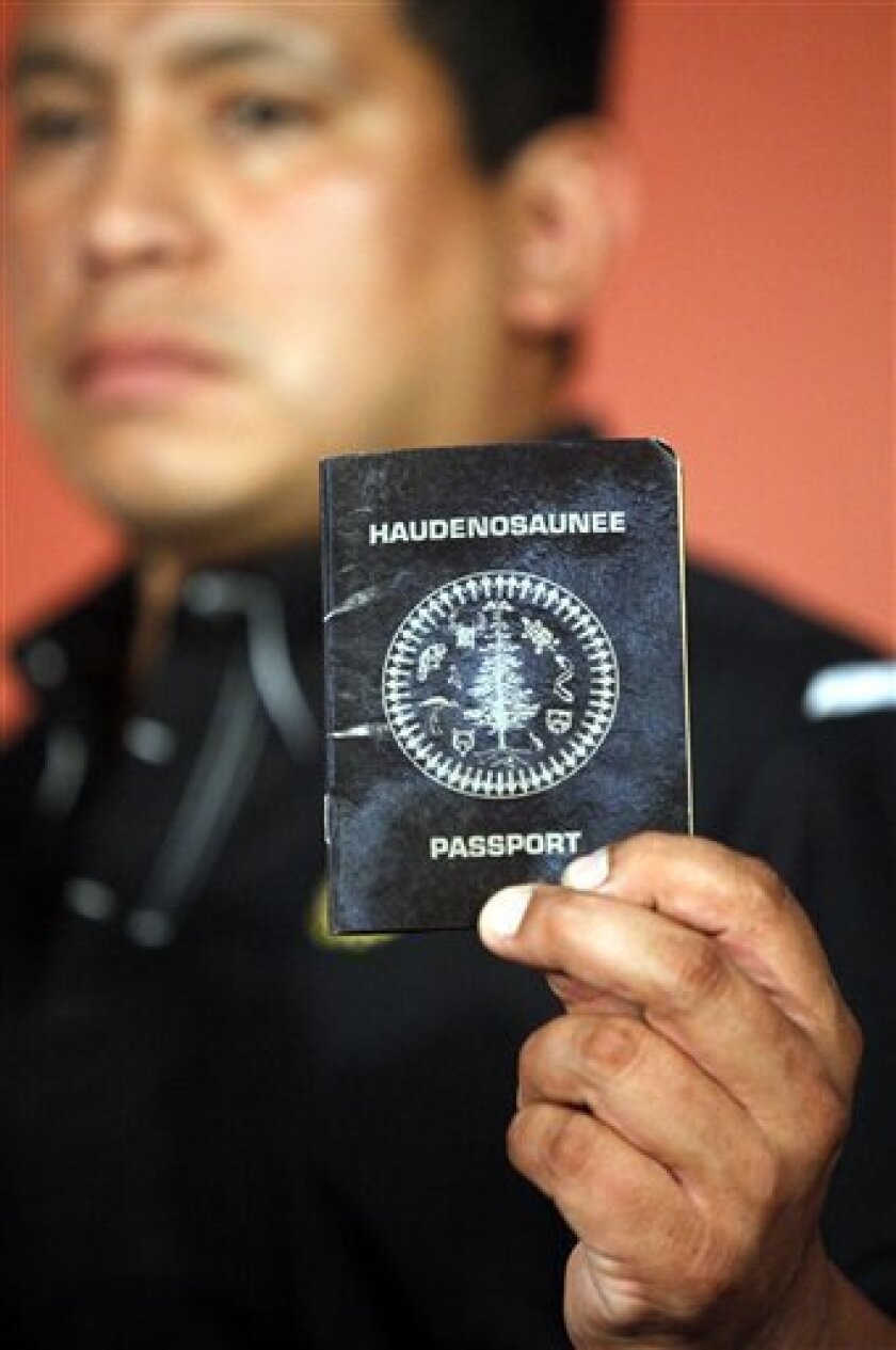Percy Abrams, Iroquois Nationals lacrosse team board of directors executive director, shows his Haudenosaunee, or Iroquois Confederacy, passport during a news conference in New York, Wednesday, July 14, 2010. The U.S. government on Wednesday agreed to let the Native American lacrosse team travel to