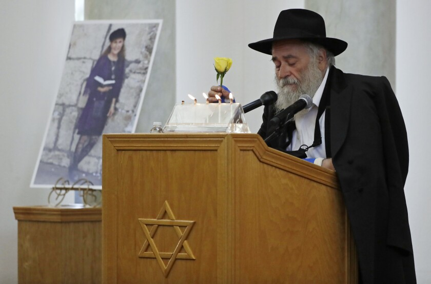 Rabbi Yisroel Goldstein  speaks at the funeral for Lori Gilbert-Kaye, killed in the attack on Chabad of Poway last year.
